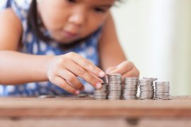 Young girl counting coins